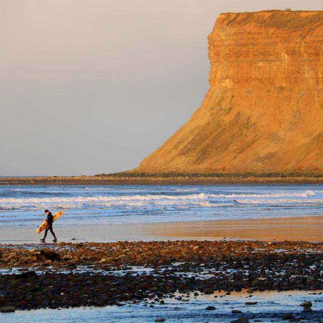 """Surfer in the Golden Hour beneath Saltburn's Huntcliff."" stock image"