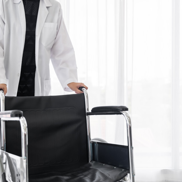 """""""Doctor hold Wheelchair"""" stock image"""