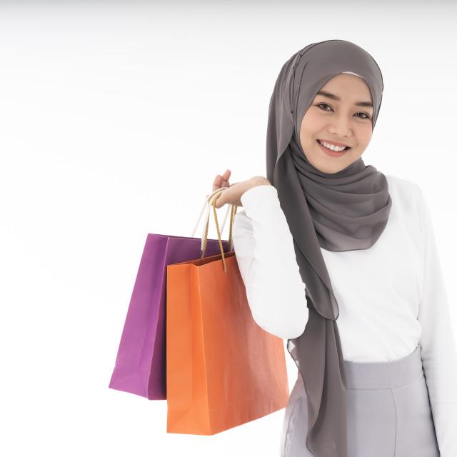 """Muslim girl shopping bags"" stock image"