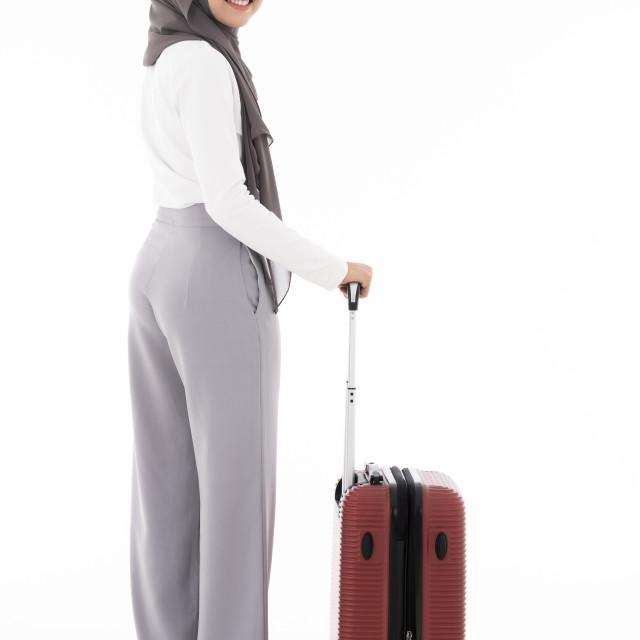 """Muslim girl luggage"" stock image"
