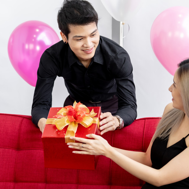 """""""Couple with new year gift box"""" stock image"""