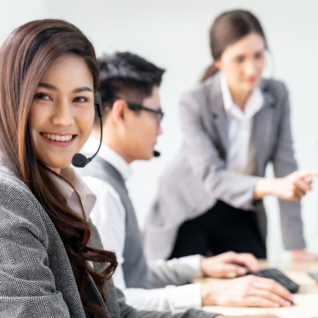"""""""Smiling call Center working"""" stock image"""
