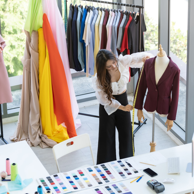 """Fashion designer owner working"" stock image"