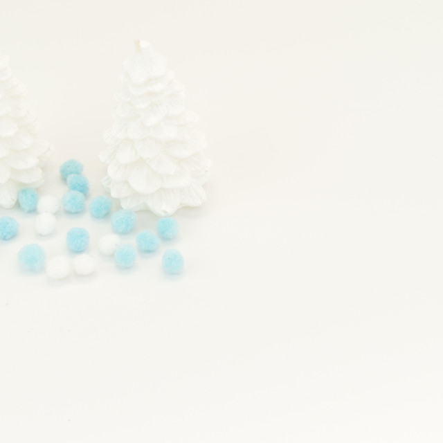 """two white christmas trees decor on a white surface"" stock image"
