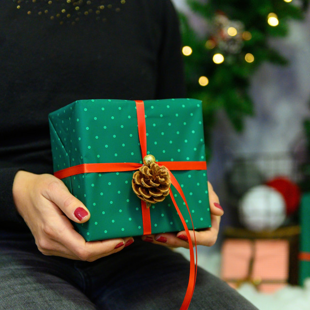"""""""Christmas gift. Congratulations.Top wiew of woman holding tradit"""" stock image"""