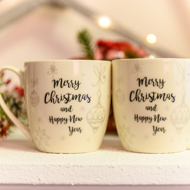 """""""White ceramic coffee cup and christmas decoration on woon table"""" stock image"""