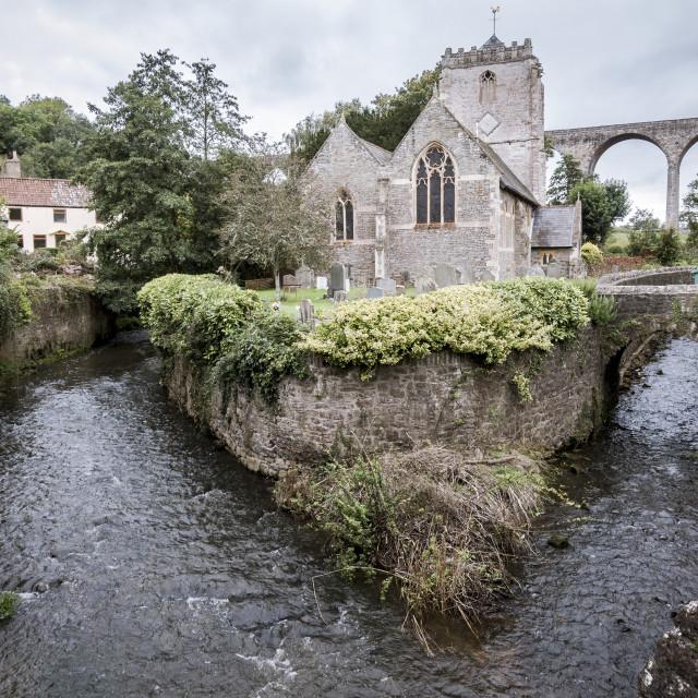 """St Thomas à Becket Church, Pensford Viaduct behind."" stock image"