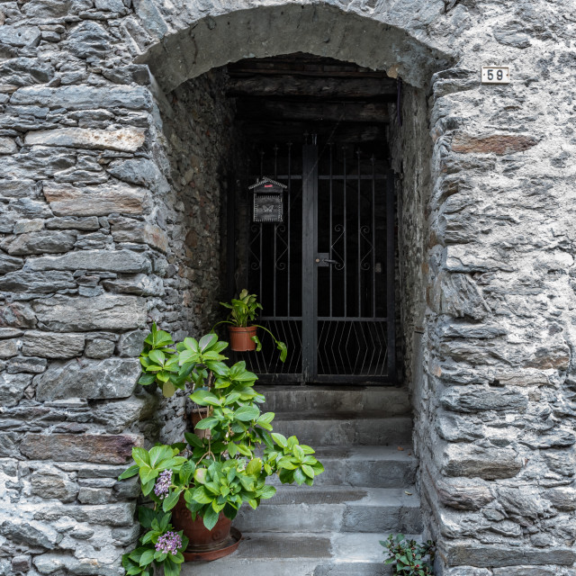 """""""Image of a characteristic gate of an ancient village"""" stock image"""