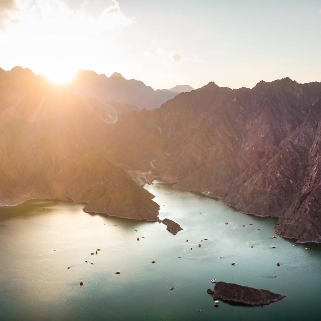 """Sunset over Hatta dam lake in Dubai emirate of UAE aerial panora"" stock image"