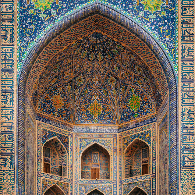 """Man in black wear enters Tilya-Kori madrasah in Registan, Samarqand, Uzbekistan"" stock image"