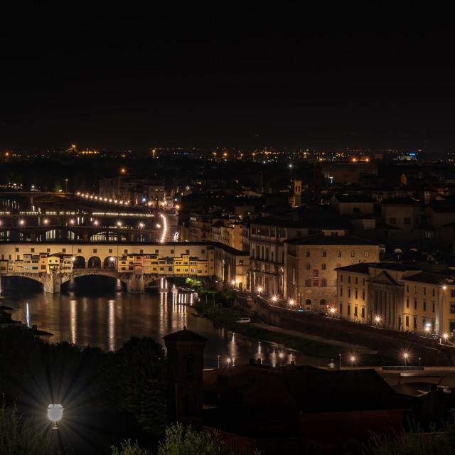 """Night view of Ponte Vecchio on the Arno river"" stock image"