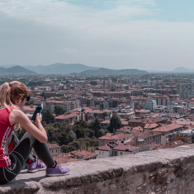 """""""landscape with view of the city of Bergamo with subject seated o"""" stock image"""