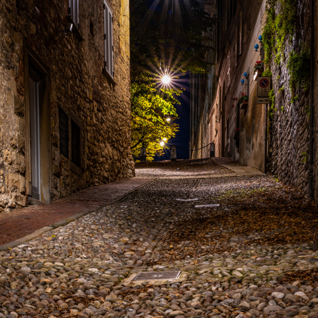 """""""Medieval street that goes up narrow towards Bergamo Alta in the"""" stock image"""