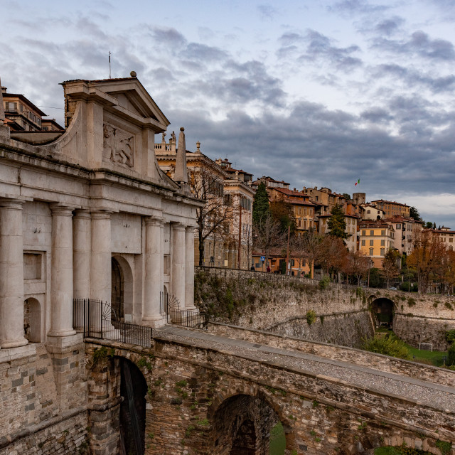 """""""Side view of Porta San Giacomo and the walls of the upper city o"""" stock image"""