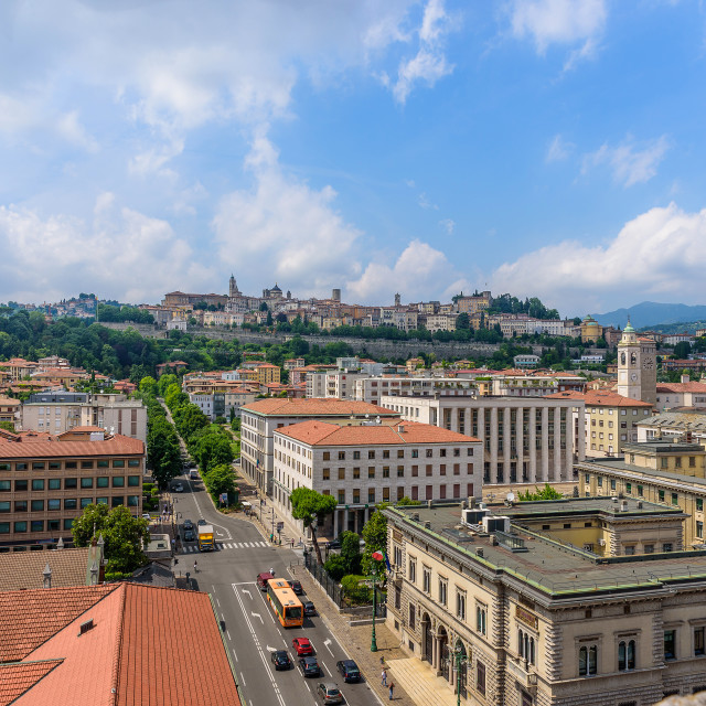 """""""Top view of Bergamo, low city and high city in the background, blue sky with some clouds"""" stock image"""