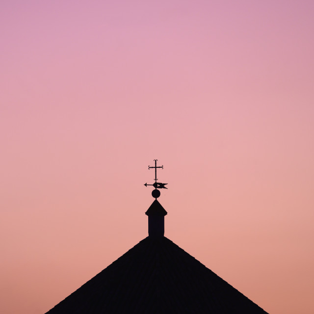 """""""SILHOUETTE OF CHURCH AGAINST COLORFUL SKY, SEVILE, SPAIN"""" stock image"""