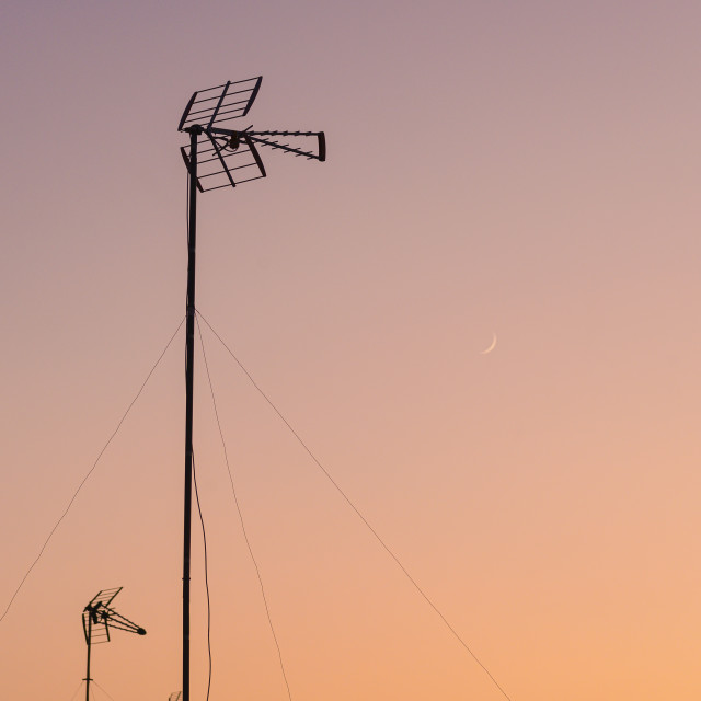 """""""ANTENNA AGAINST LATE EVEING SKY WITH MOON, SEVILLE, SPAIN"""" stock image"""