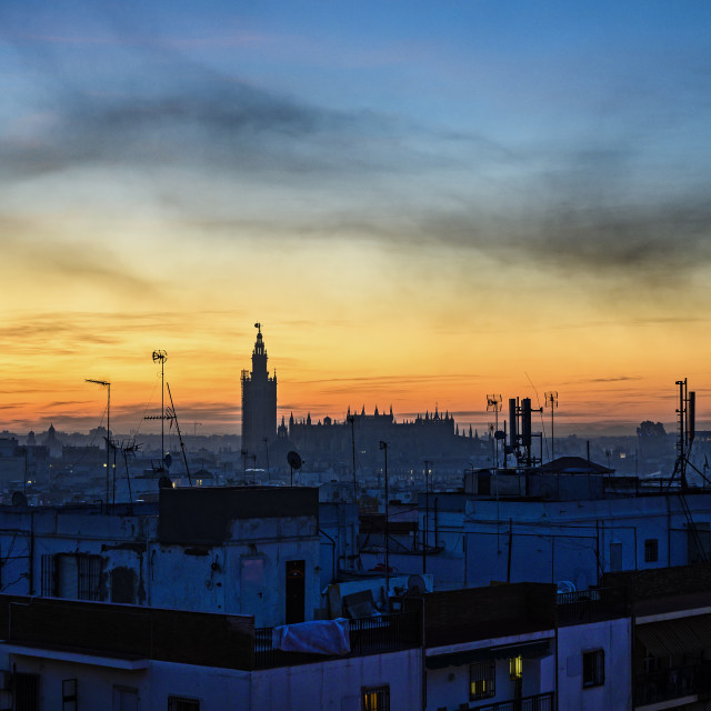 """""""VIEW ACROSS SEVILLE TO THE CATHEDRAL AT DAWN, SEVILLE, SPAIN"""" stock image"""