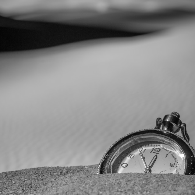 """""""Pocket watch buried into the desert sand"""" stock image"""
