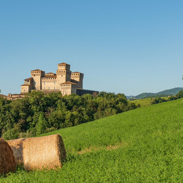 """""""Italian castle and hay bales"""" stock image"""