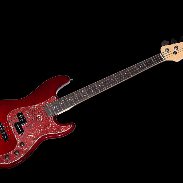 """""""Bass guitar in cherry-colored wood on a black background"""" stock image"""