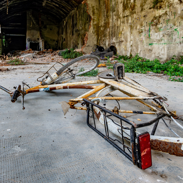 """""""Bicycle fallen to the ground in an abandoned and ruined place"""" stock image"""