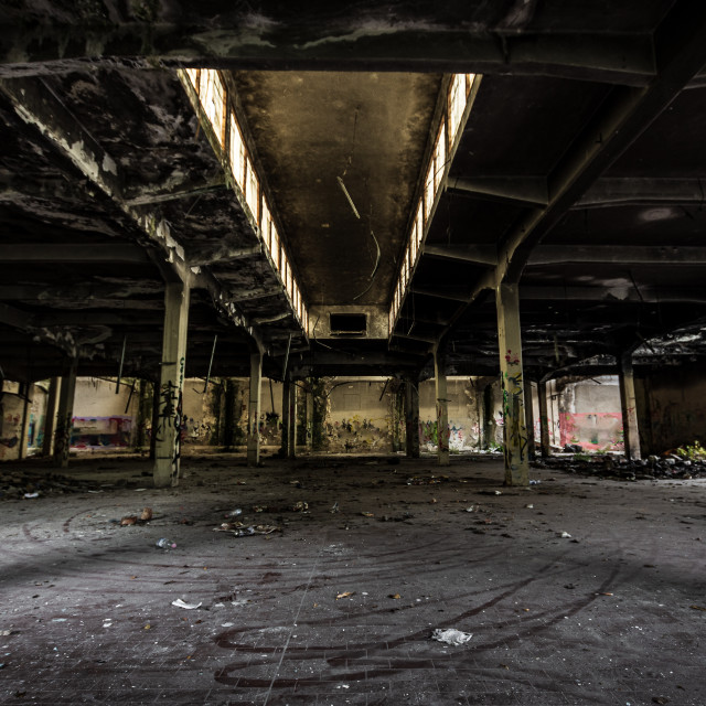 """""""Inside an old abandoned industrial building"""" stock image"""