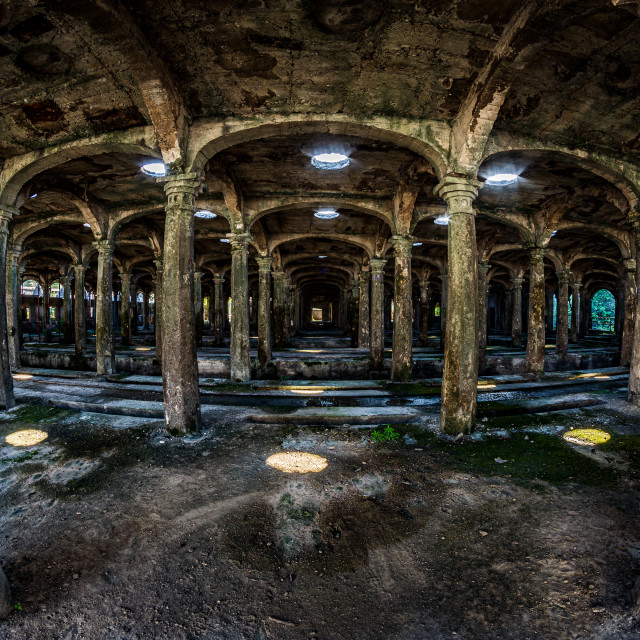 """""""Room in an abandoned industrial area with many columns"""" stock image"""