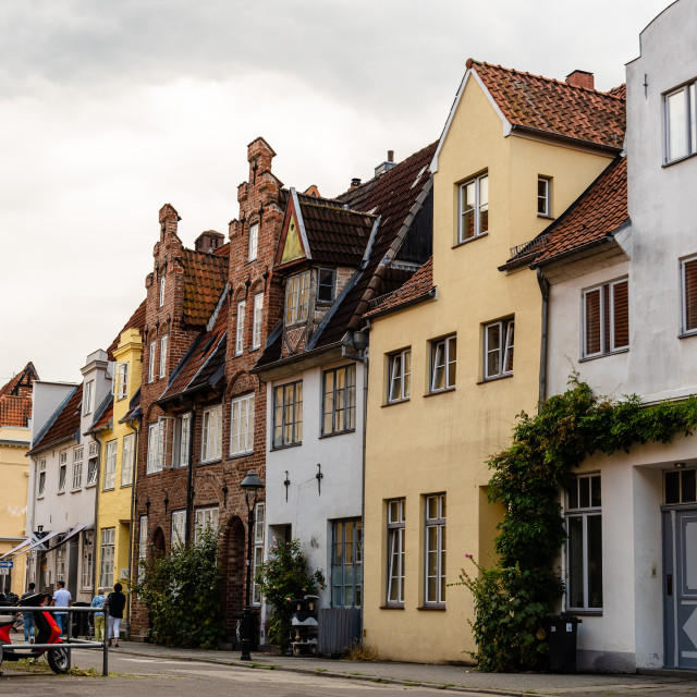 """Scenic view of beautiful brick houses in historic centre of Lubeck, Germany"" stock image"
