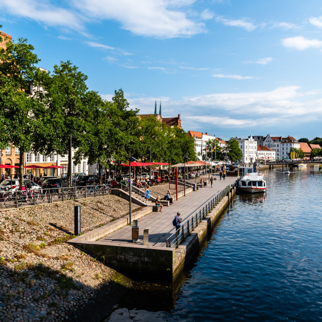 """Scenic view of Trave River and waterfront in the old harbour in Lubeck, Germany"" stock image"