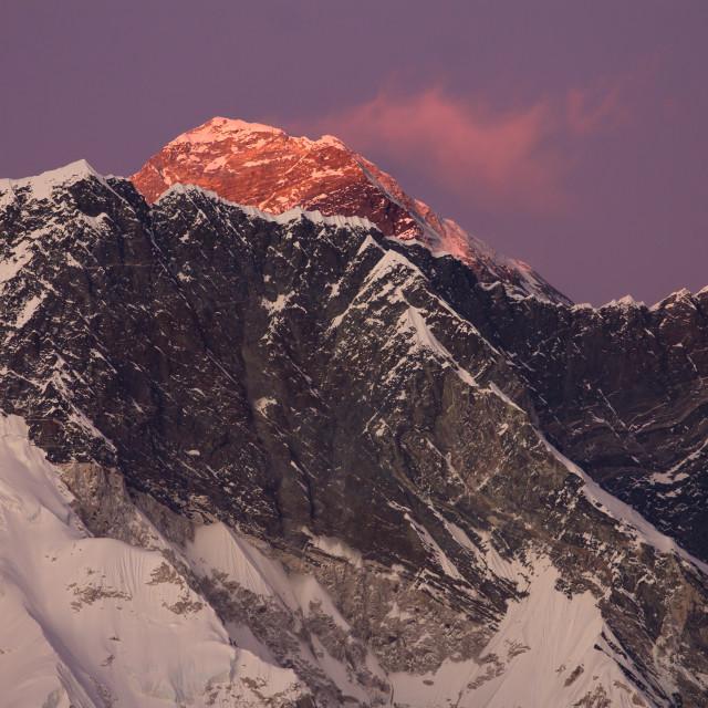 """Mt. Everest rising above the Nuptse-Lhotse Ridge at dusk"" stock image"