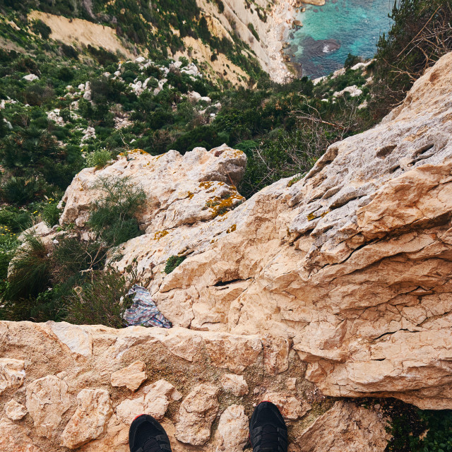 """""""Unrecognizable man stands on the edge of cliff, limestone mounta"""" stock image"""