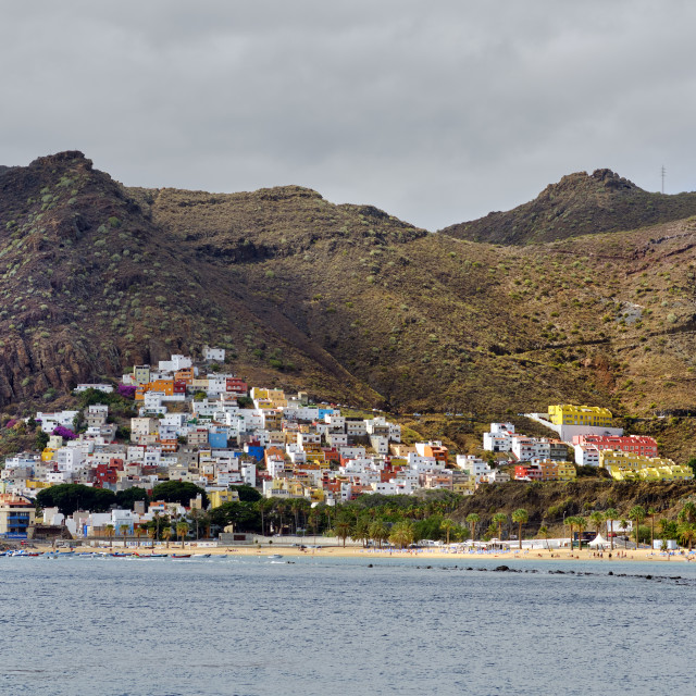 """Distant waterside view to Playa de Las Teresitas beach hillside"" stock image"