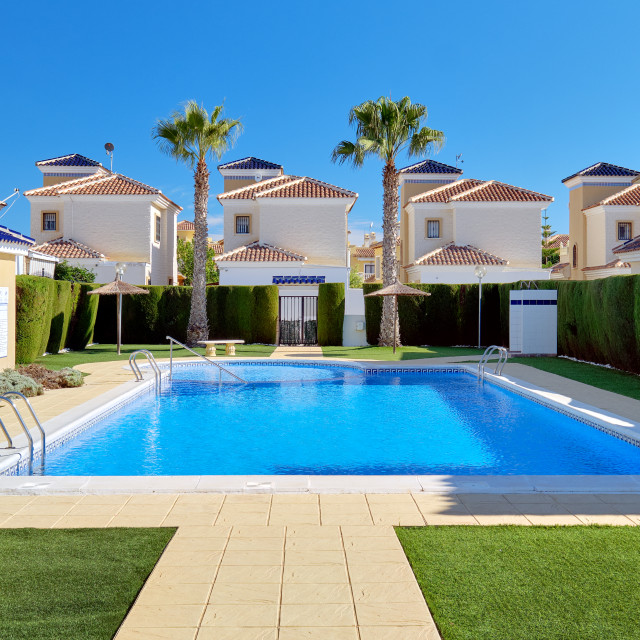"""""""Torrevieja, Spain - November 4, 2019: Modern apartments with pub"""" stock image"""