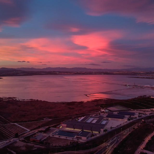 """""""Bright cloudy sky purple violet pink colors sunset over Torrevie"""" stock image"""
