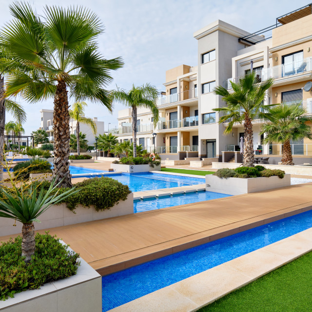 """""""Torrevieja, Spain - October 28, 2019: Modern apartments with swi"""" stock image"""