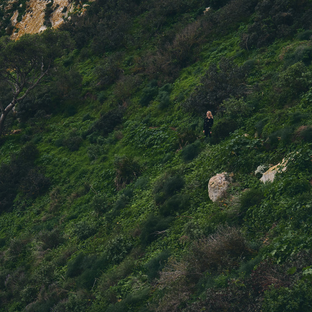 """Woman during hiking climbing up at Natural Park of Penyal d'Ifac"" stock image"