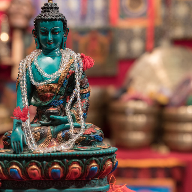 """""""Buddha statuette exposed in an Asian market"""" stock image"""