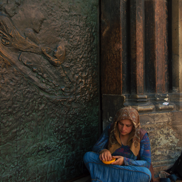 """""""Charity, young girl begging outside a church"""" stock image"""