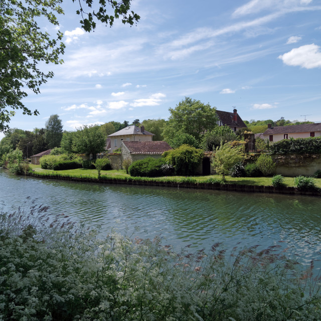 """Loing river in Nemours village"" stock image"