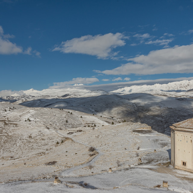 """""""Top view of the snowy mountains of Abruzzo and the church of San"""" stock image"""