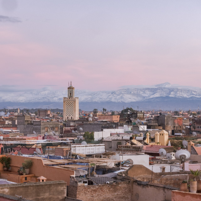 """""""Panoramic view of Marrakesh at sunset with Atlas mountains in background, Marrakesh, Morocco."""" stock image"""