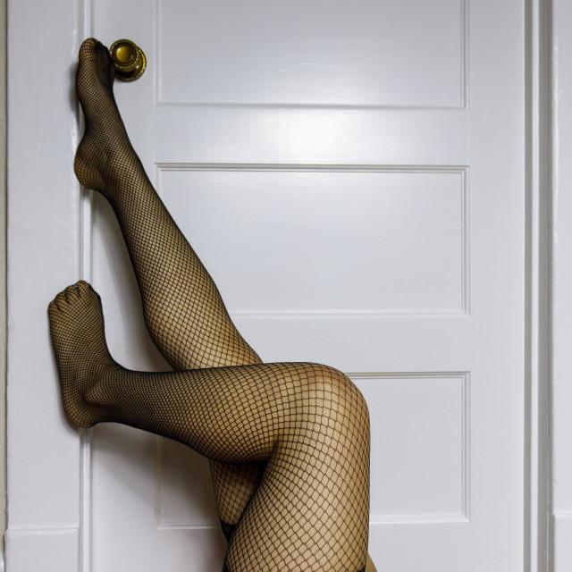 """Legs in Black Fishnet Framed in a Doorway"" stock image"