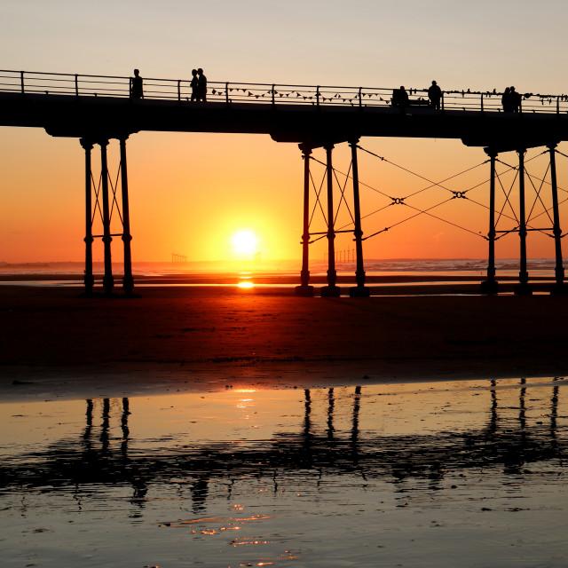 """""""Sun setting beneath Saltburn pier"""" stock image"""