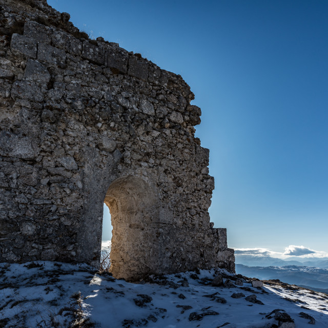 """""""Remains of an ancient fortress on the snowy mountains"""" stock image"""