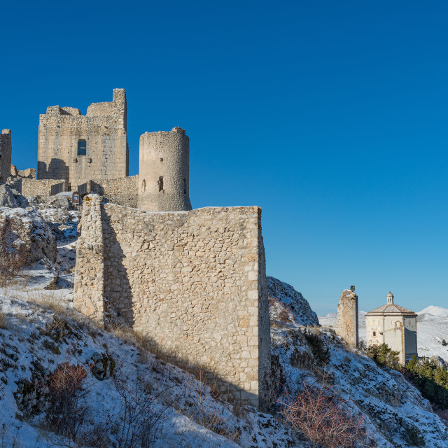 """""""Ancient fortification and small church in the snowy mountains"""" stock image"""