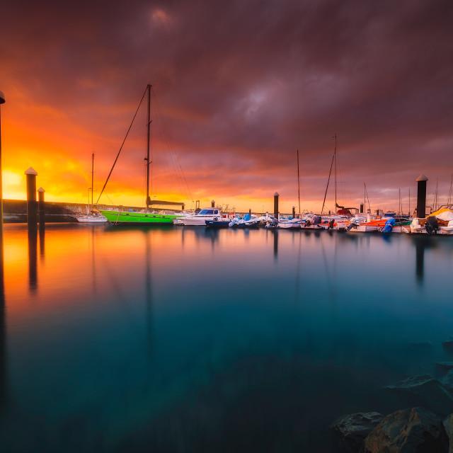 """Magic dawn on taliarte harbour"" stock image"