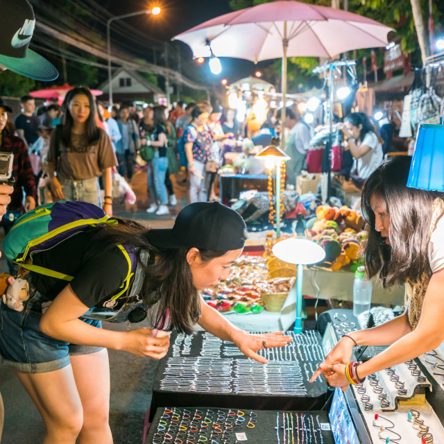 """""""Young Asian tourists at the Saturday Night Bazaar"""" stock image"""