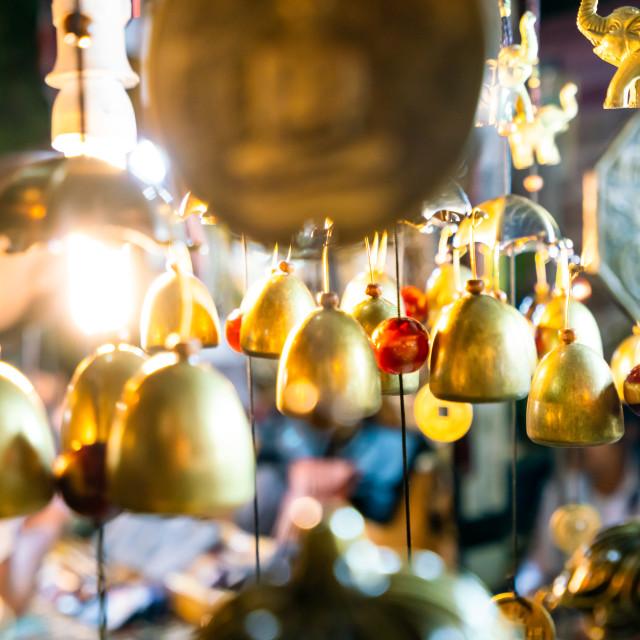 """Decorative bells hanging at the Saturday Night Bazaar"" stock image"