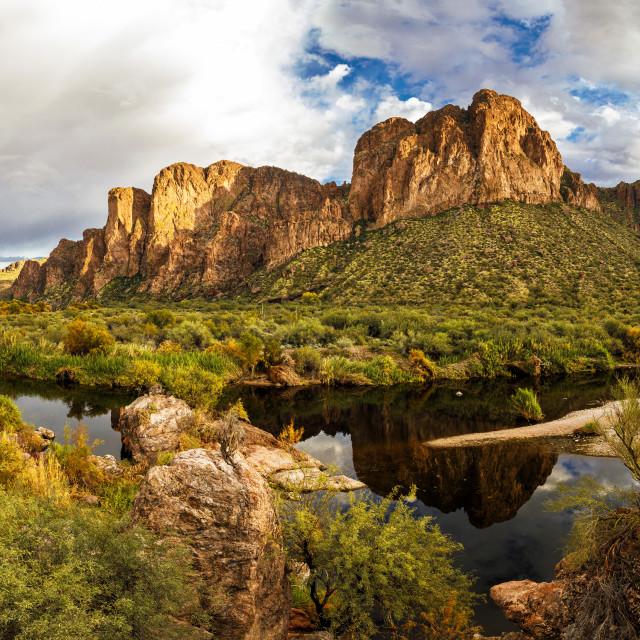 """Desert Mountain Reflecting in the Salt River in Arizona"" stock image"